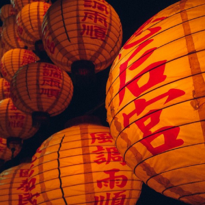 Chinese paper lanterns lit with writing on them